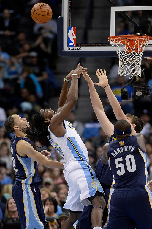 . Denver Nuggets forward Kenneth Faried (35) is defended by Memphis Grizzlies forward Tayshaun Prince (21), forward Zach Randolph (50) and center Marc Gasol (33) during the third quarter of action. (Photo by AAron Ontiveroz/The Denver Post)