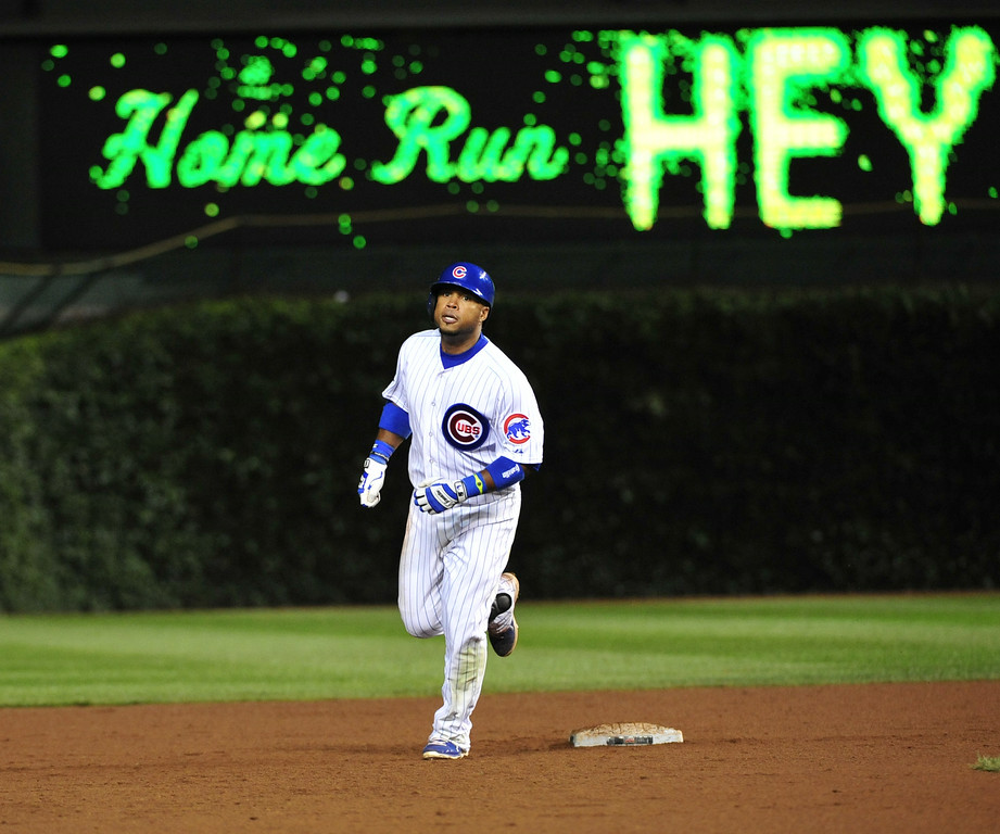 . CHICAGO, IL - JULY 30:  Luis Valbuena #24 of the Chicago Cubs rounds the bases after hitting a two-run home run against the Colorado Rockies during the eighth inning on July 30, 2014 at Wrigley Field in Chicago, Illinois. (Photo by David Banks/Getty Images)