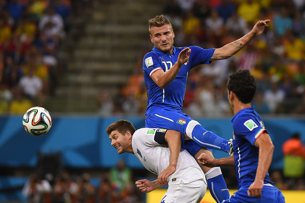 . Italy\'s forward Ciro Immobile and England\'s midfielder and captain Steven Gerrard (L) vie for the ball during a Group D football match between England and Italy at the Amazonia Arena in Manaus during the 2014 FIFA World Cup on June 14, 2014.   AFP PHOTO / FABRICE COFFRIN