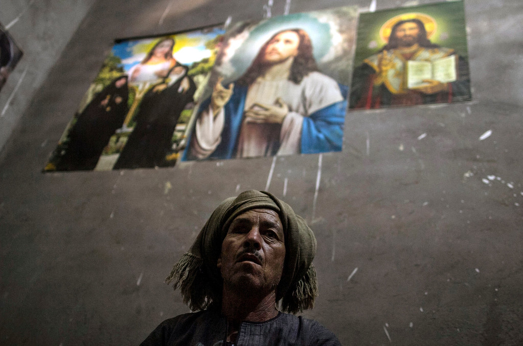 . In this Sept. 3, 2013, photo, an Egyptian Christian villager takes shelter inside his house in Dalga, Minya province, Egypt. Dalga has been outside government control since hard-line supporters of the Islamist Mohammed Morsi drove out police and occupied their station on July 3, the day Egypt\'s military chief removed the president in a popularly supported coup. It was part of a wave of attacks in the southern Minya province that targeted Christians, their homes and businesses. (AP Photo/El Shorouk Newspaper, Roger Anis)