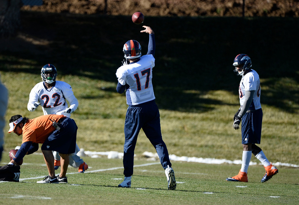 . Denver Broncos quarterback Brock Osweiler (17) throws a pass to C.J. Anderson (22) during practice November 27, 2013 at Dove Valley (Photo by John Leyba/The Denver Post)
