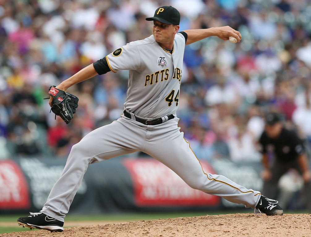 . Pittsburgh Pirates relief pitcher Tony Watson works against the Colorado Rockies in the seventh inning of the Pirates\' 7-5 victory in a baseball game in Denver on Sunday, July 27, 2014. (AP Photo/David Zalubowski)