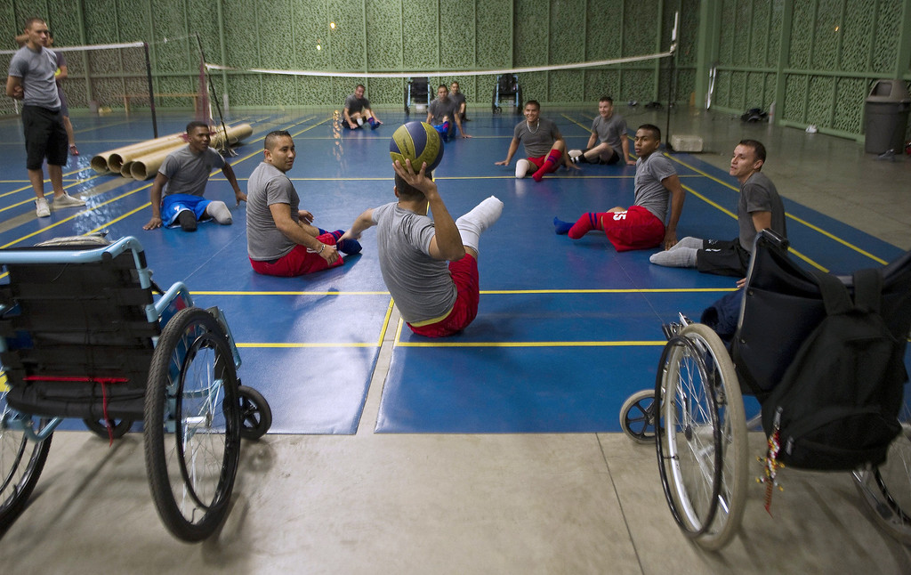 . Colombian soldiers victims of land mine explosions play volleyball game during their rehabilitation therapy session at the Heroes de Paramillo hospital.  RAUL ARBOLEDA/AFP/Getty Images