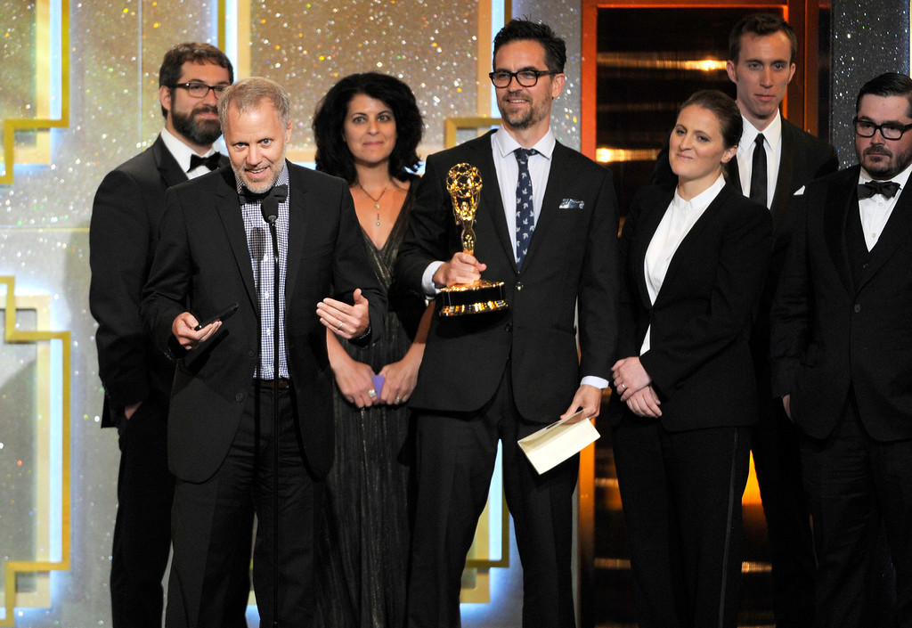 . The cast of ìThe Mind of a Chefî accepts the award for outstanding culinary program at the 41st annual Daytime Emmy Awards at the Beverly Hilton Hotel on Sunday, June 22, 2014, in Beverly Hills, Calif. (Photo by Chris Pizzello/Invision/AP)