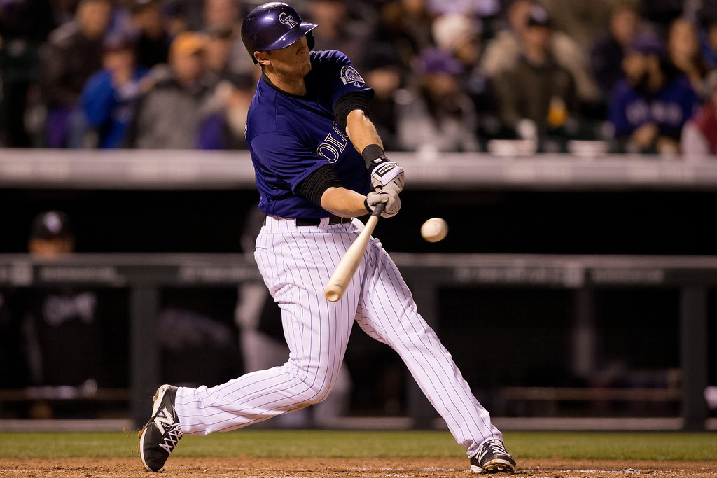 . DJ LeMahieu #9 of the Colorado Rockies hits an RBI single during the fifth inning against the Chicago White Sox at Coors Field on April 7, 2014 in Denver, Colorado. (Photo by Justin Edmonds/Getty Images)