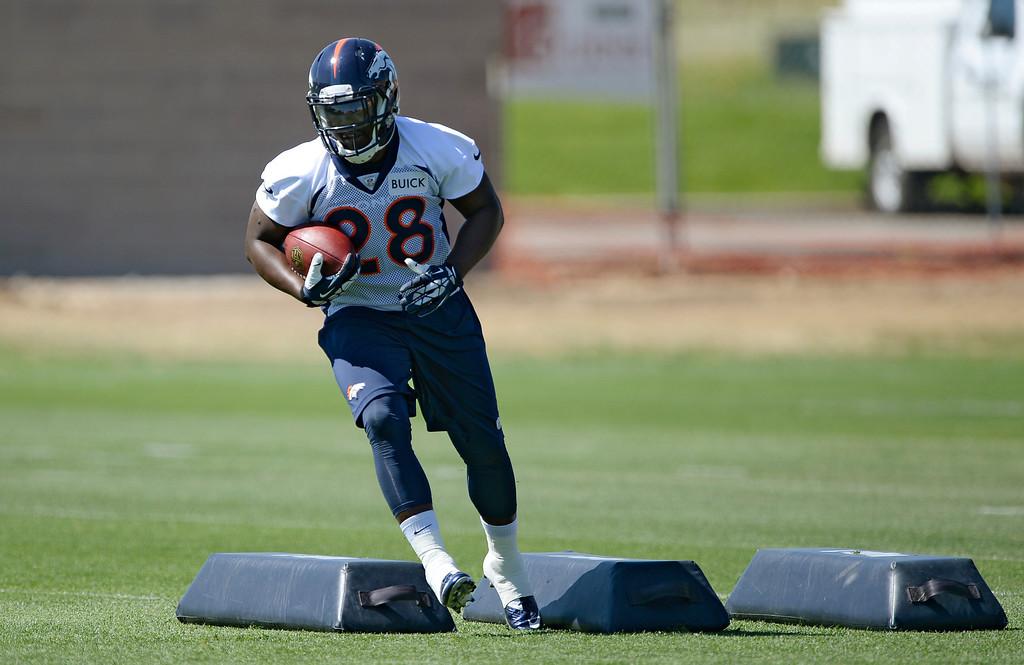 . Denver Broncos running back Montee Ball (28) runs through drills  during OTAs June 2, 2014 at Dove Valley. (Photo by John Leyba/The Denver Post)