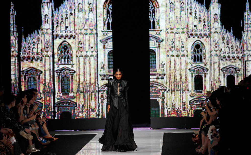 . A model displays a creation by Indonesian designer Ivon Limadhy during the Jakarta Fashion Week in Jakarta, Indonesia, Monday, Oct. 21, 2013. (AP Photo/Achmad Ibrahim)
