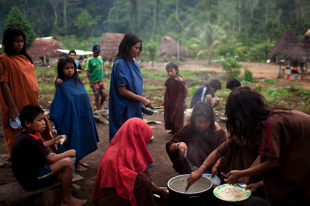 . In this Oct. 1, 2013 photo, Ashaninka Indian women gather around a communal pot to fill their bowls with a fish soup made with yuca and sweet potatoes, in the village Kitamaronkani, Pichari district, Peru. The Ashaninka are the largest indigenous group in Peru�s sparsely populated Amazon region but still account for less than 1 percent of the South American country�s 30 million people. The people subsist largely on yuca, a diet they supplement with fish and wild rodents known as pacas. (AP Photo/Rodrigo Abd)