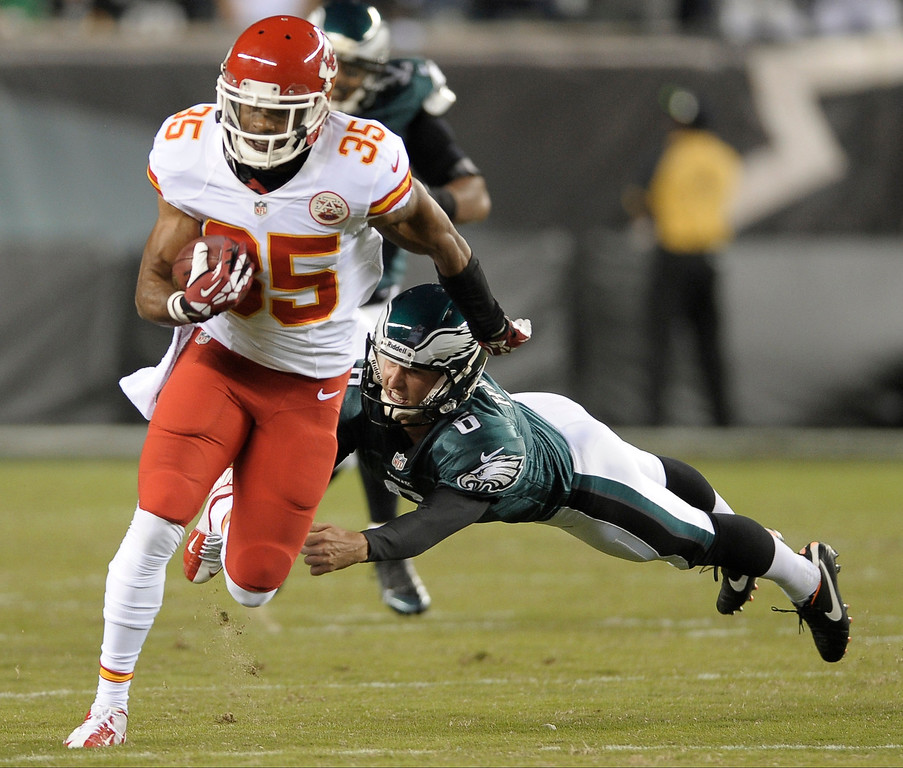 . Kansas City Chiefs\' Quintin Demps returns a kickoff as Philadelphia Eagles kicker Alex Henery tries to make the tackle during the first half of an NFL football game, Thursday, Sept. 19, 2013, in Philadelphia. (AP Photo/Michael Perez)