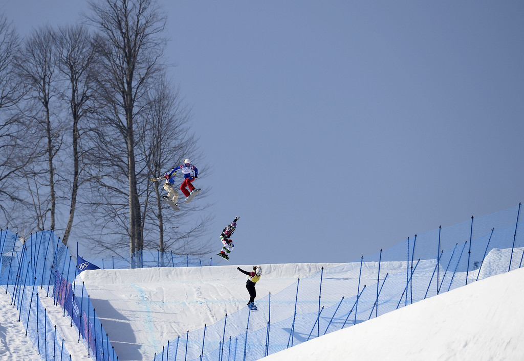 . Athletes race in the big final in the Women\'s Snowboard Cross at the Rosa Khutor Extreme Park during the Sochi Winter Olympics on February 16, 2014.    FRANCK FIFE/AFP/Getty Images