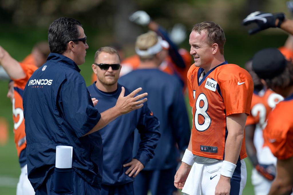 . Denver Broncos quarterback Peyton Manning (18) talks with quarterbacks coach Greg Knapp before practice September 19, 2013 at Dove Valley. (Photo by John Leyba/The Denver Post)