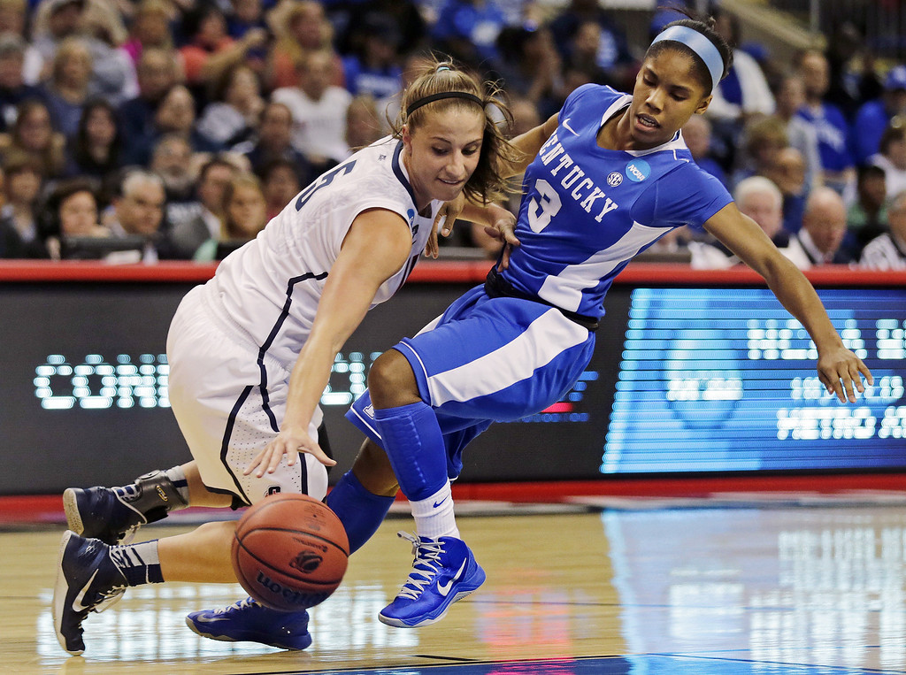 . Connecticut guard Caroline Doty, left, collides with Kentucky guard Janee Thompson, right, in the first half of a women\'s NCAA regional final basketball game in Bridgeport, Conn., Monday, April 1, 2013. (AP Photo/Charles Krupa)