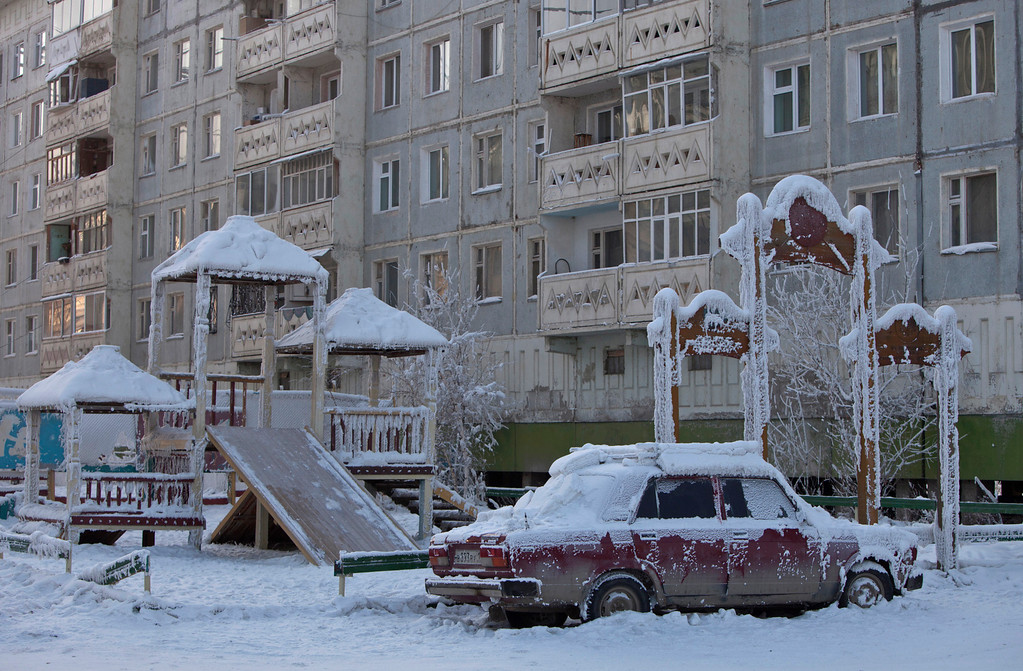 . A car covered in ice is pictured near a playground in Yakutsk, in the Republic of Sakha, northeast Russia, February 4, 2013. The coldest temperatures in the northern hemisphere have been recorded in Sakha, the location of the Oymyakon valley, where according to the United Kingdom Met Office a temperature of -67.8 degrees Celsius (-90 degrees Fahrenheit) was registered in 1933 - the coldest on record in the northern hemisphere since the beginning of the 20th century. Yet despite the harsh climate, people live in the valley, and the area is equipped with schools, a post office, a bank, and even an airport runway (albeit open only in the summer).    Picture taken February 4, 2013.    REUTERS/Maxim Shemetov