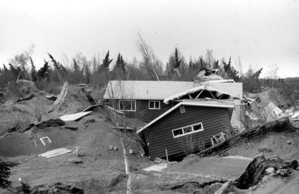. Alaska Earthquake March 27, 1964. Earthquake-damaged houses in Turnagain Heights in Anchorage. U.S. Geological Survey photo