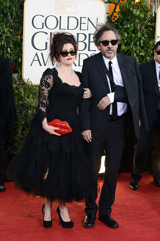 . Actress Helena Bonham Carter(L) and director Tim Burton arrive at the 70th Annual Golden Globe Awards held at The Beverly Hilton Hotel on January 13, 2013 in Beverly Hills, California.  (Photo by Jason Merritt/Getty Images)