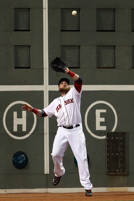 . Jonny Gomes #5 of the Boston Red Sox makes a catch against the St. Louis Cardinals during Game Six of the 2013 World Series at Fenway Park on October 30, 2013 in Boston, Massachusetts.  (Photo by Rob Carr/Getty Images)