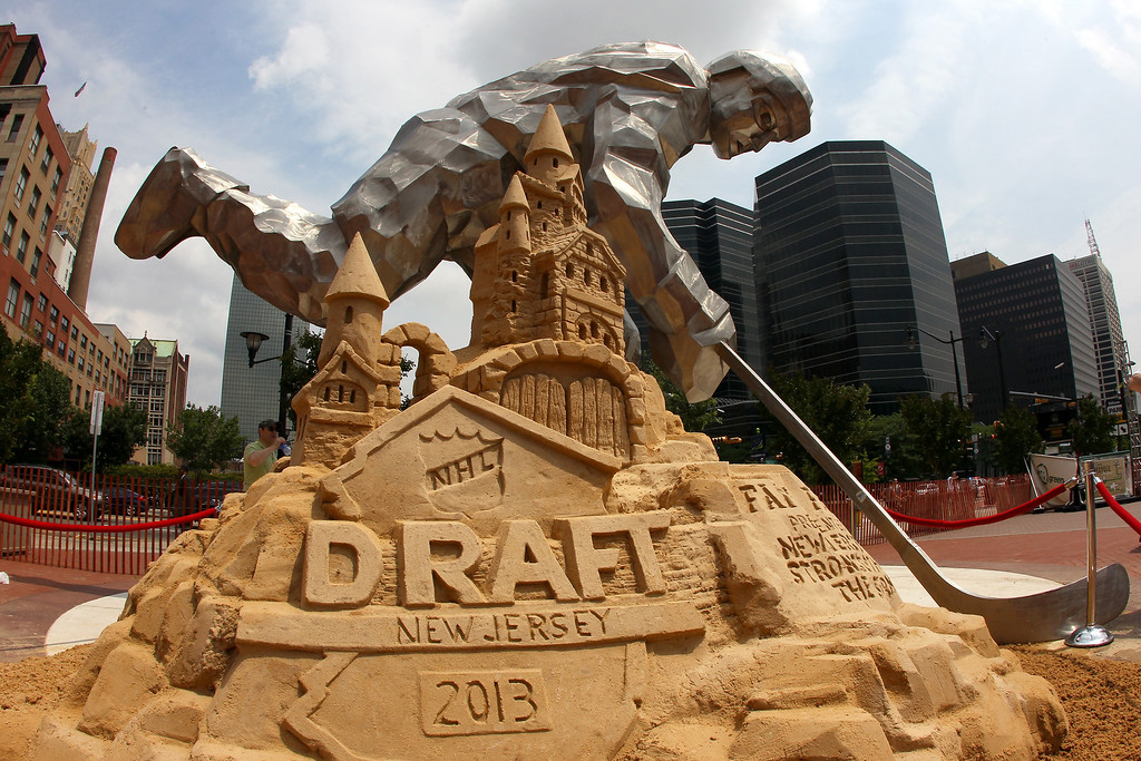 . A view of a sand sculpture in front a stainless steel hockey player during the 2013 NHL Draft Fan Fest and Memorabilia Show at the Prudential Center on June 30, 2013 in Newark, New Jersey.  (Photo by Mike Stobe/Getty Images)