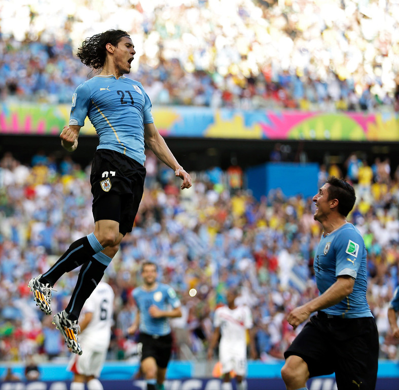 . Uruguay\'s Edinson Cavani, left, celebrates with Cristian Rodriguez after Cavani kicked a penalty shot to score his side\'s first goal during the group D World Cup soccer match between Uruguay and Costa Rica at the Arena Castelao in Fortaleza, Brazil, Saturday, June 14, 2014.  (AP Photo/Natacha Pisarenko)