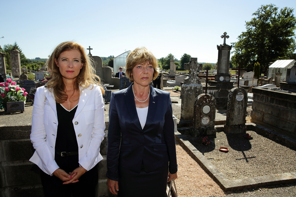 . French President Francois Hollande\'s companion Valerie Trierweiler, left, and German President Joachim Gauck\'s partner Daniela Schadt attend a ceremony at the cemetery of the French martyr village of Oradour-sur-Glane, southwestern France, Wednesday, Sept. 4, 2013. Holding hands in quiet tribute, the presidents of Germany and France are visiting the scene of the largest massacre in Nazi-occupied France nearly seven decades ago. Wednesday\'s visit by German President Joachim Gauck to the southwestern French town of Oradour-sur-Glane is the first by a serving German leader. (AP Photo/ Phillipe Wojazer, Pool)