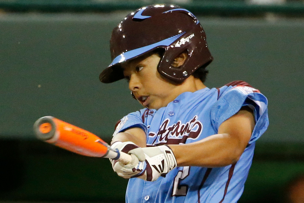 . Philadelphia\'s Jack Rice drives in two runs with a single off Chicago\'s Marquis Jackson in the first inning of an elimination baseball game at the Little League World Series tournament in South Williamsport, Pa., Thursday, Aug. 21, 2014. (AP Photo/Gene J. Puskar)