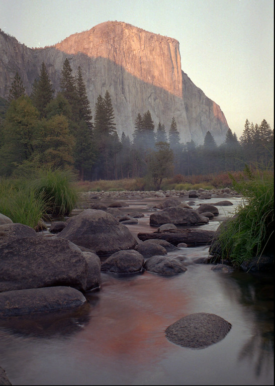 . One of the last autumn sunsets drapes El Capitan and the Yosemite valley with warm light Tuesday, Oct. 21, 1997, in Yosemite National Park. (AP Photo/Ben Margot)