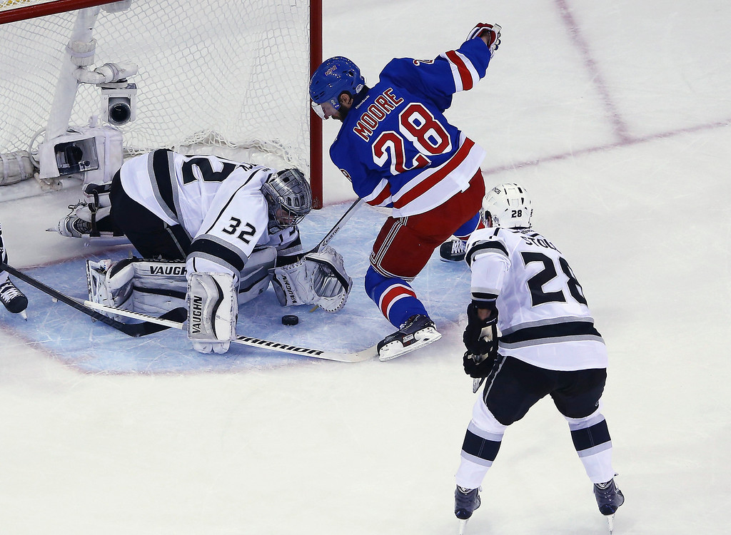 . Jonathan Quick #32 of the Los Angeles Kings makes a save on Dominic Moore #28 of the New York Rangers during the first period of Game Four of the 2014 NHL Stanley Cup Final at Madison Square Garden on June 11, 2014 in New York, New York.  (Photo by Al Bello/Getty Images)