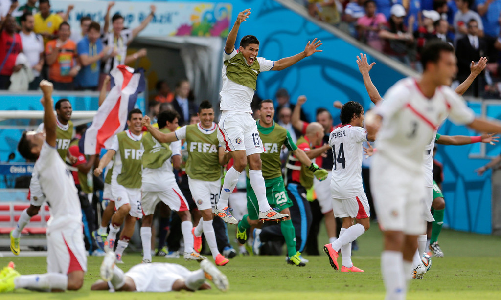 . Costa Rican players come off their bench to celebrate their 1-0 victory over Italy during the group D World Cup soccer match between Italy and Costa Rica at the Arena Pernambuco in Recife, Brazil, Friday, June 20, 2014.  (AP Photo/Petr David Josek)