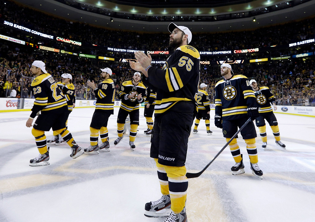. Boston Bruins defenseman Johnny Boychuk (55) and teammates celebrate after defeating the Pittsburgh Penguins 1-0 in Game 4 of the Eastern Conference finals of the NHL hockey Stanley Cup playoffs, in Boston on Friday, June 7, 2013. The Bruins advanced to the Stanley Cup finals.  (AP Photo/Elise Amendola)