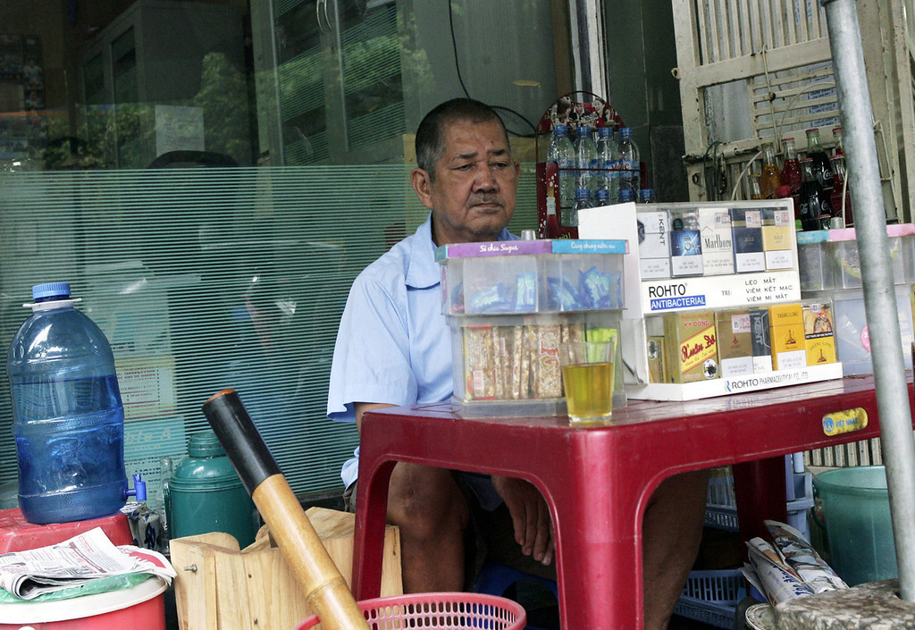 . Truong Tien Thao, 65, waits for customers at his small tea stall on a sidewalk in downtown Hanoi, Vietnam on Thursday, Sept. 26, 2013. Thao is acutely aware that he, like millions of others, is plunging into old age without a safety net. He wishes he could retire, but he and his 61-year-old wife depend on the $50 a month they earn from the tea shop. (AP Photo/Tran Van Minh)