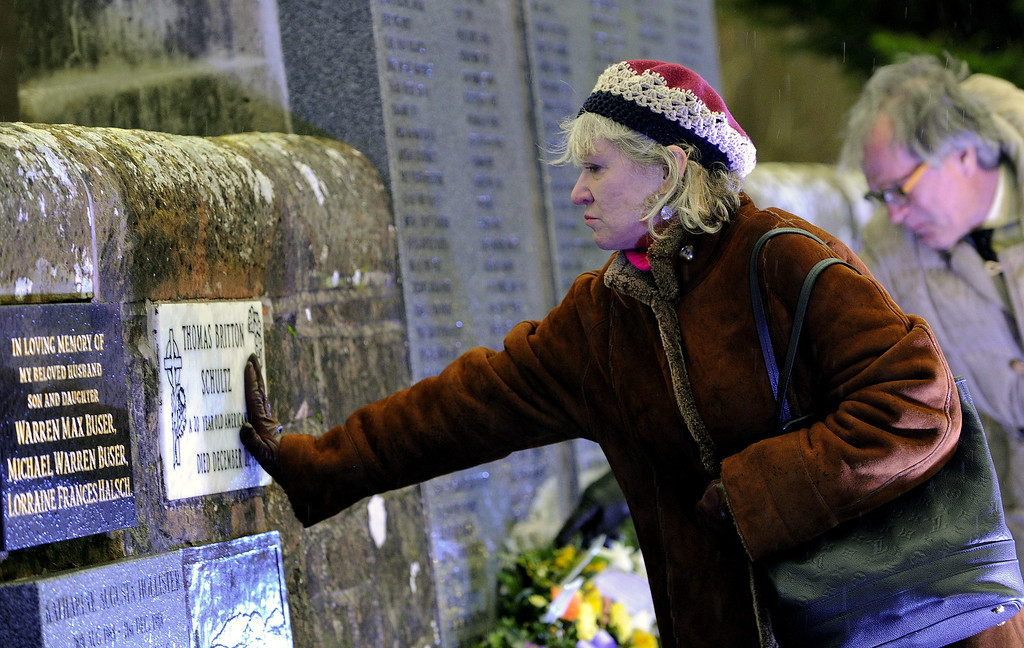 . Relatives of those killed in the Lockerbie air disaster pay their respects at the 25th anniversary memorial service for the disaster at Dryfesdale cemetery on December 21, 2013 in Lockerbie, Scotland.   (Photo by Ian Forsyth/Getty Images)