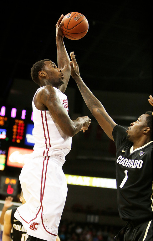 . Washington State\'s D.J. Shelton, left, attempts a jump shot against Coloradoís Wesley Gordon during the first half of an NCAA college basketball game Wednesday, Jan. 8, 2014, in Spokane, Wash. (AP Photo/Young Kwak)