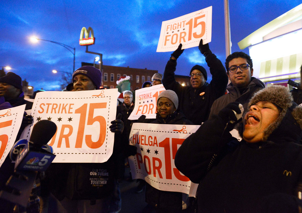 . Demonstrators rally for better wages outside a McDonald\'s restaurant in Chicago, Thursday, Dec., 5, 2013. Demonstrations planned in 100 cities are part of push by labor unions, worker advocacy groups and Democrats to raise the federal minimum wage of $7.25. (AP Photo/Paul Beaty)