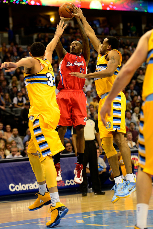 . Denver Nuggets shooting guard Andre Iguodala (9) and center JaVale McGee (34) pressure Los Angeles Clippers shooting guard Jamal Crawford (11) during the second half of the Nugget\'s 92-78 win at the Pepsi Center on Tuesday, January 1, 2013. AAron Ontiveroz, The Denver Post