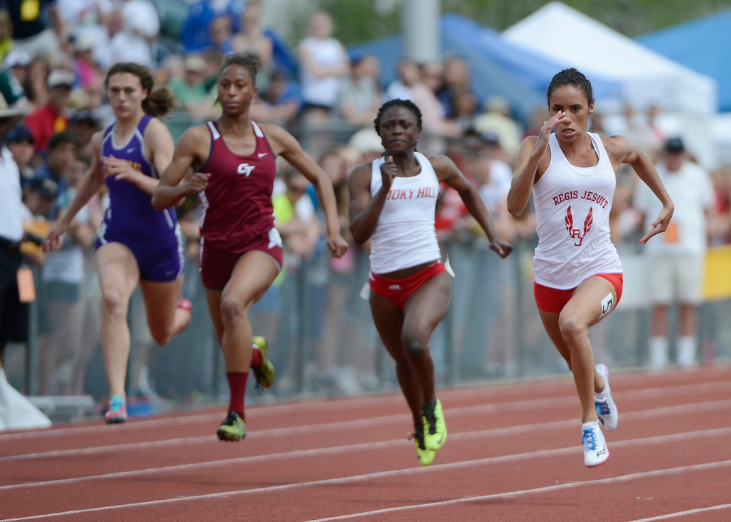 . Ana Holland, right, Regis Jesuit, sprints down track against competitors from left to right, Josephine Petruska, Ft. Collins, Shayna Yon, Cherokee Trail high School, and Zainab Sanni, Smoky Hill High School, to win the girls 5A 100 meter race at the Colorado State Track and Field Championships at Jeffco Stadium, Saturday, May 18, 2013. Holland won with a time of 11.33, a new meet record. (AP Photo/The Denver Post, Andy Cross)