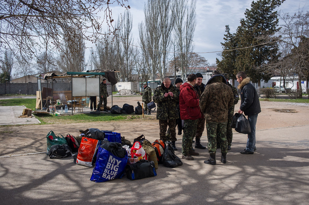 . Ukrainian servicemen pile up their things after leaving the Ukrainian navy headquarters stormed by Crimean pro-Russian self-defense forces in Sevastopol, Crimea, Wednesday, March 19, 2014.   (AP Photo/Andrew Lubimov)