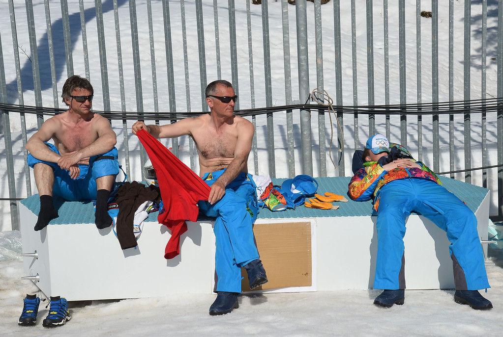 . Volunteers enjoy a sunbath before the Women\'s Cross-Country Skiing 4x5km Relay at the Laura Cross-Country Ski and Biathlon Center during the Sochi Winter Olympics on February 15, 2014, in Rosa Kutor, near Sochi. ALBERTO PIZZOLI/AFP/Getty Images