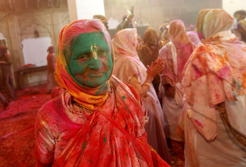 . An Indian widow is covered with colored powder while participating in the Holi festival in Vrindavan, Uttar Pradesh, India, March 14, 2014.  EPA/HARISH TYAGI