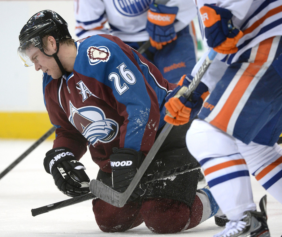 . DENVER, CO. - DECEMBER 19: Colorado center Paul Stastny struggled to his feet after getting cross checked in the face late in the first period. The Colorado Avalanche hosted the Edmonton Oilers in an NHL game at the Pepsi Center Thursday night, December 19, 2013.  Photo By Karl Gehring/The Denver Post