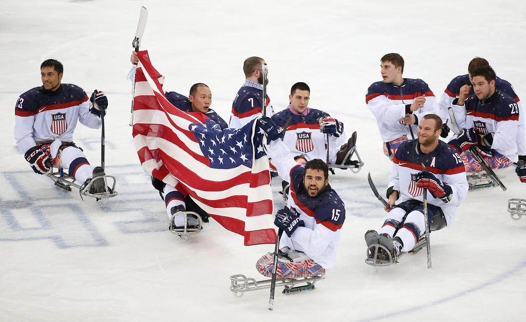 . United States players celebrate as they win the gold medal after their ice sledge hockey match against Russia at the 2014 Winter Paralympics in Sochi, Russia, Saturday, March 15, 2014. United States won 1-0. (AP Photo/Pavel Golovkin)