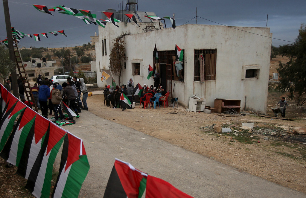 . Relatives and friends of Palestinian prisoner Said al-Tamimi prepare his home after receiving the news of his impending release from an Israeli jail, in the West Bank village of Nabi Saleh, on December 29, 2013. Israel prepared today to free 26 Palestinian prisoners as part of peace talks brokered by US Secretary of State John Kerry, who is due back in the region to boost the faltering negotiations.  ABBAS MOMANI/AFP/Getty Images
