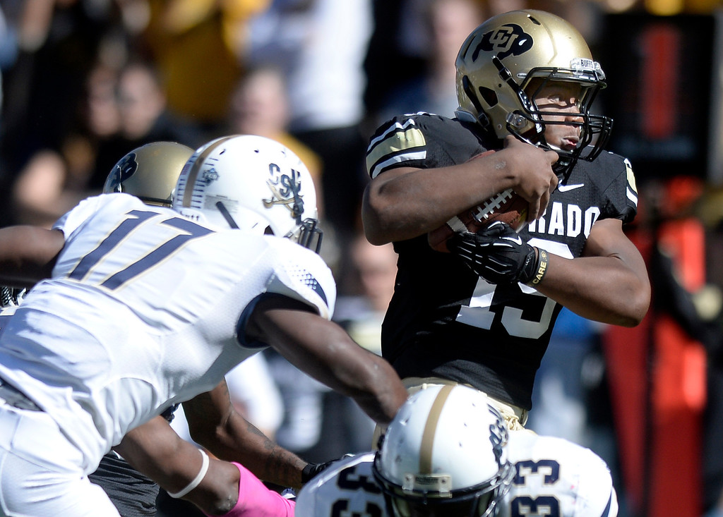 . University of Colorado\'s Michael Adkins II runs the ball in for a touchdown during a game against Charleston Southern on Saturday, Oct. 19, at Folsom Field in Boulder.  (Jeremy Papasso/Boulder Daily Camera)