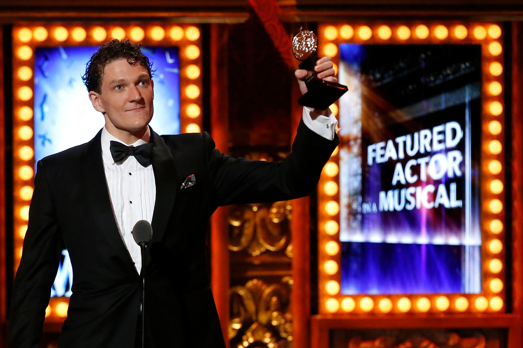 ". Actor Gabriel Ebert accepts the award for Best Performance by an Actor in a Featured Role in a Musical in ""Matilda the Musical\"" during the American Theatre Wing\'s annual Tony Awards in New York June 9, 2013. REUTERS/Lucas Jackson"