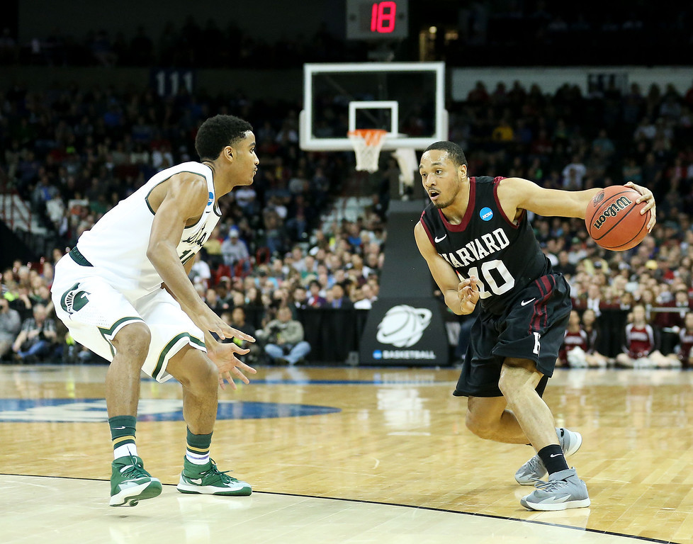. SPOKANE, WA - MARCH 22:  Brandyn Curry #10 of the Harvard Crimson drives against Gary Harris #14 of the Michigan State Spartans during the Third Round of the 2014 NCAA Basketball Tournament at Spokane Veterans Memorial Arena on March 22, 2014 in Spokane, Washington.  (Photo by Stephen Dunn/Getty Images)