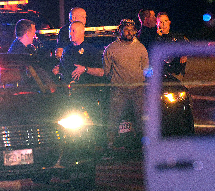 . Police put rapper Schoolboy Q in handcuffs during an investigation into a shooting that occurred at Red Rocks Amphitheater Thursday night, June 19, 2014. Schoolboy Q was in a Chevy Suburban with at least three other people that was hit by gunfire at Red Rocks Park in Jefferson County late Thursday night. The vehicle was stopped by Denver police at 7th Avenue and Kalamath Street and three people were sent by ambulance to a local hospitall. Photo by Karl Gehring/The Denver Post