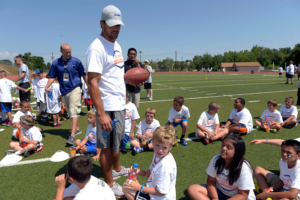 . Eric Decker talks with some of the campers before breaking in to their groups for a game. Demaryius Thomas and Eric Decker team up with ProCamps for their football camp held at Littleton High School July 11, 2013.(Photo By John Leyba/The Denver Post)