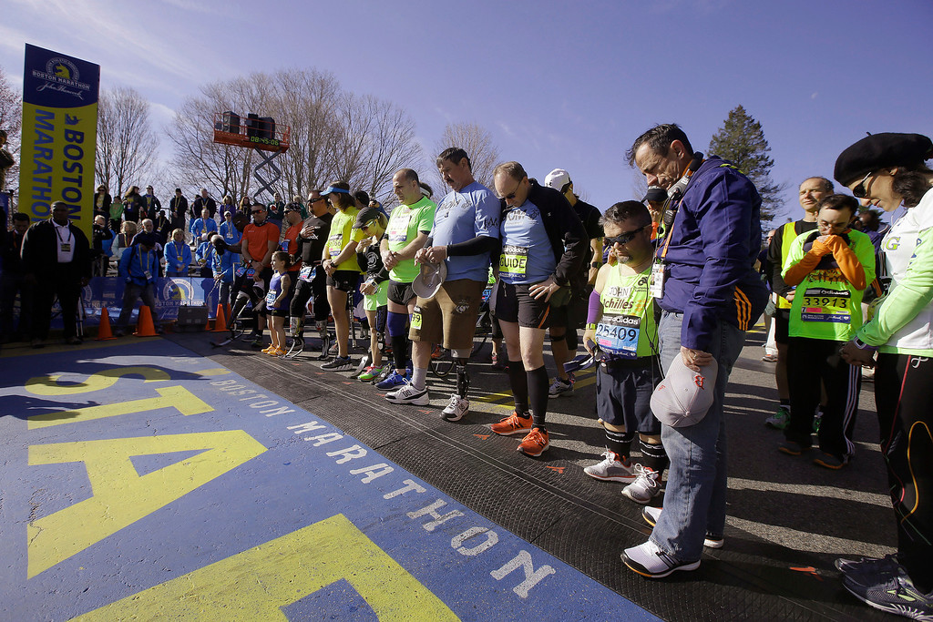 . Mobility-impaired runners gather at the start line for a moment of silence before the 118th Boston Marathon Monday, April 21, 2014 in Hopkinton, Mass. (AP Photo/Stephan Savoia)