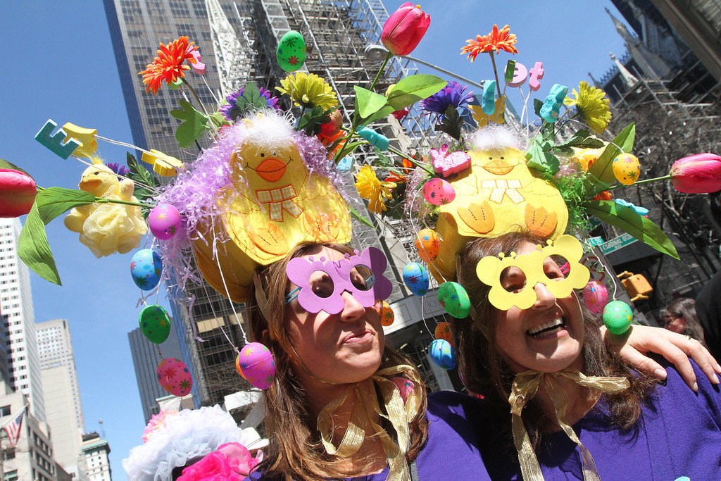 . Dressed for the occasion, Paige Capala, left, and her mother Karen Zandri pose for photographs as they take part in the Easter Parade along New York\'s Fifth Avenue, Sunday, April 20, 2014. (AP Photo/Tina Fineberg)