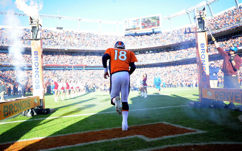 . Denver Broncos quarterback Peyton Manning (18) heads on to the field prior to the game.  The Denver Broncos vs Cleveland Browns at Sports Authority Field Sunday December 23, 2012. Photo by John Leyba, The Denver Post