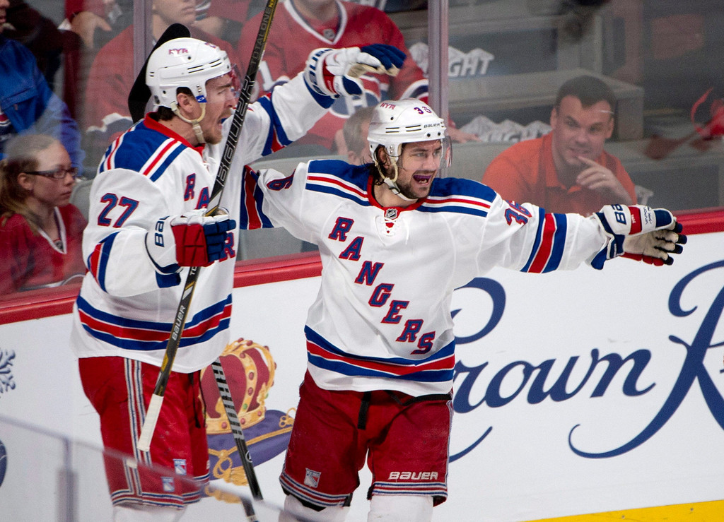 . New York Rangers defenseman Ryan McDonagh, left, and left wing Mats Zuccarello celebrate after Zuccarello scored against the Montreal Canadiens during the first period in Game 1 of the Eastern Conference finals in the NHL hockey Stanley Cup playoffs in Montreal on Saturday, May 17, 2014. (AP Photo/The Canadian Press, Adrian Wyld