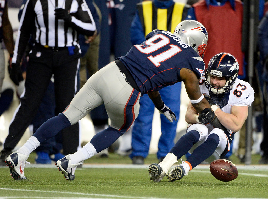 . Denver Broncos wide receiver Wes Welker (83) can\'t handle a pass from Peyton Manning as New England Patriots outside linebacker Jamie Collins (91) comes in on defense during the overtime period November 24, 2013 at Gillette Stadium. (Photo by John Leyba/The Denver Post)